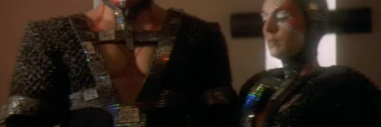 """Screengrab from the DS9 episode """"Rules of Acquisition,"""" showing the exposed chest of a Dosi man."""