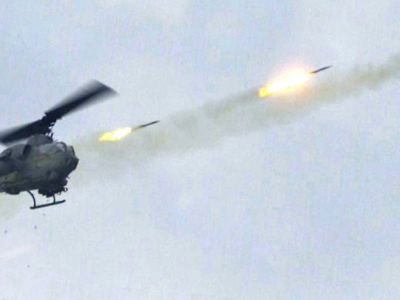 A helicopter shooting missiles.